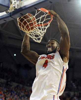 Patric Young scores on a thundering slam against Tennessee. Photo credit to AP